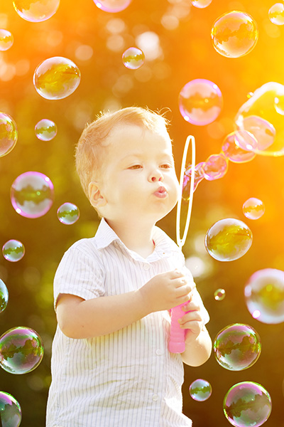 Child-blowing-bubbles